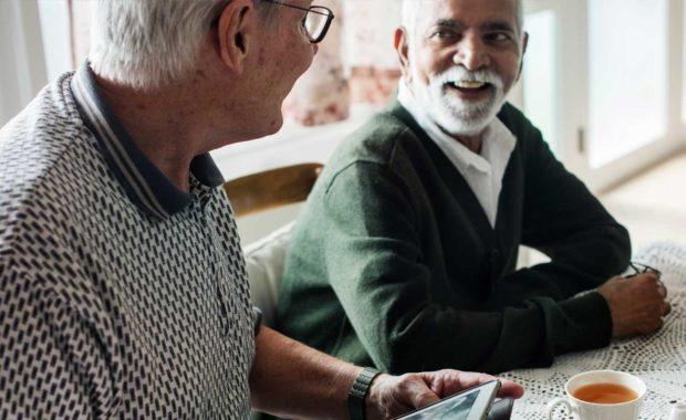 scnova-volunteer-going-over-health-plan-with-elder-man