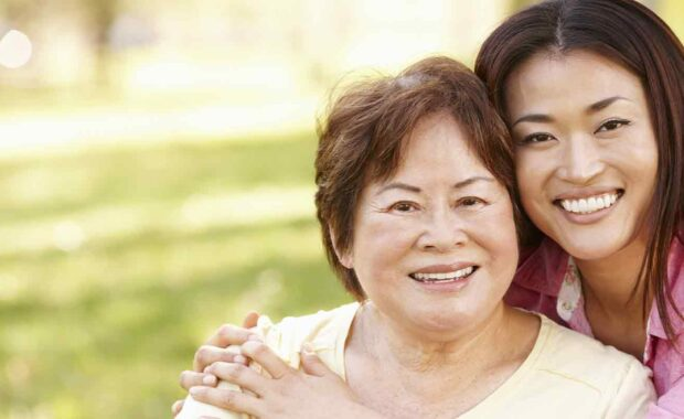 smiling while women is Caring For Aging Parents