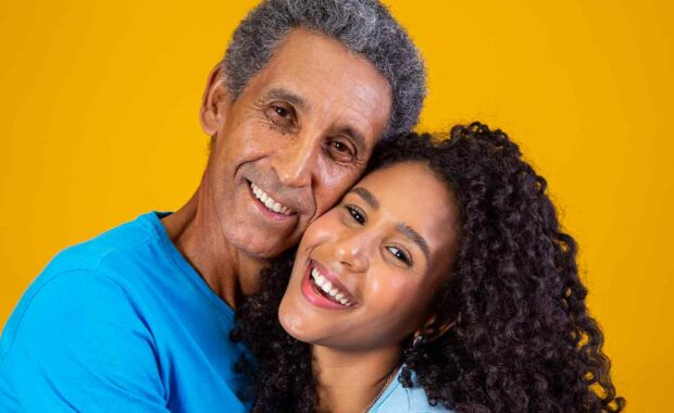 girl smiling with her dad while she is Caring For The Elderly